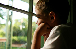 Boy with Asperger Syndrome looking out the window - ASPEN-NJ